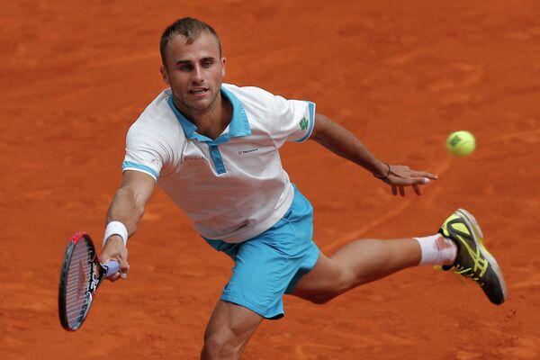 Румынский теннисист Мариус Копил