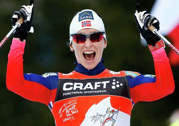 Марит Бьёрген на финише последнего этапа многодневки Тур де Ски