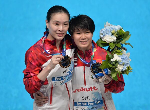 Ши Тинмао и У Минься (Китай)