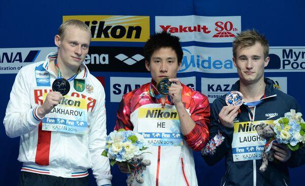 Илья Захаров (Россия) - серебряная медаль, Хэ Чао (Китай) - золотая медаль, Джек Дэвид Лафер (Великобритания) - бронзовая медаль (слева направо)