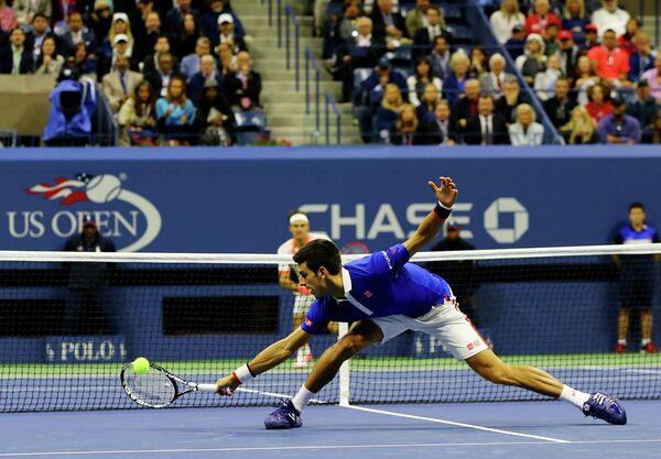 Финальный матч US Open между Новаком Джоковичем (на первом плане) и Роджером Федерером