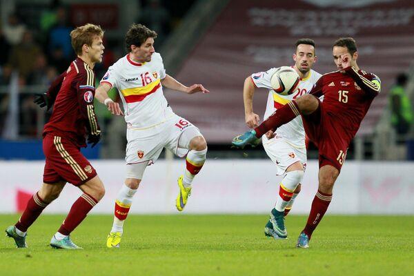 Игровой момент матча Россия - Черногория
