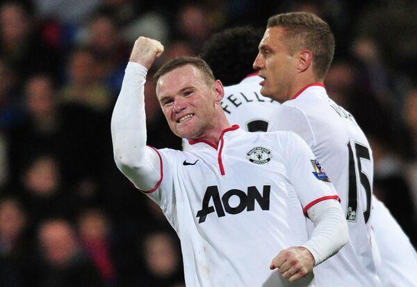 Нападающий Манчестер Юнайтед Уэйн Руни радуется забитому мячу, 2014 года