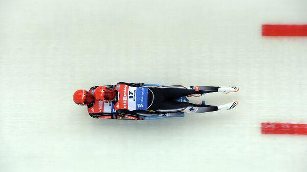 Тони Эггерт и Саша Бенеккен в соревнованиях двоек на чемпионате Европы по санному спорту