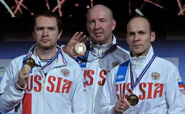 Российские спортсмены Антон Гурьянов, Владимир Исаков и Владимир Гончаров (слева направо)