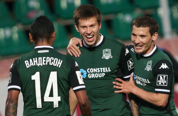 Футболисты Краснодара Вандерсон, Фёдор Смолов и Николай Марков (слева направо)